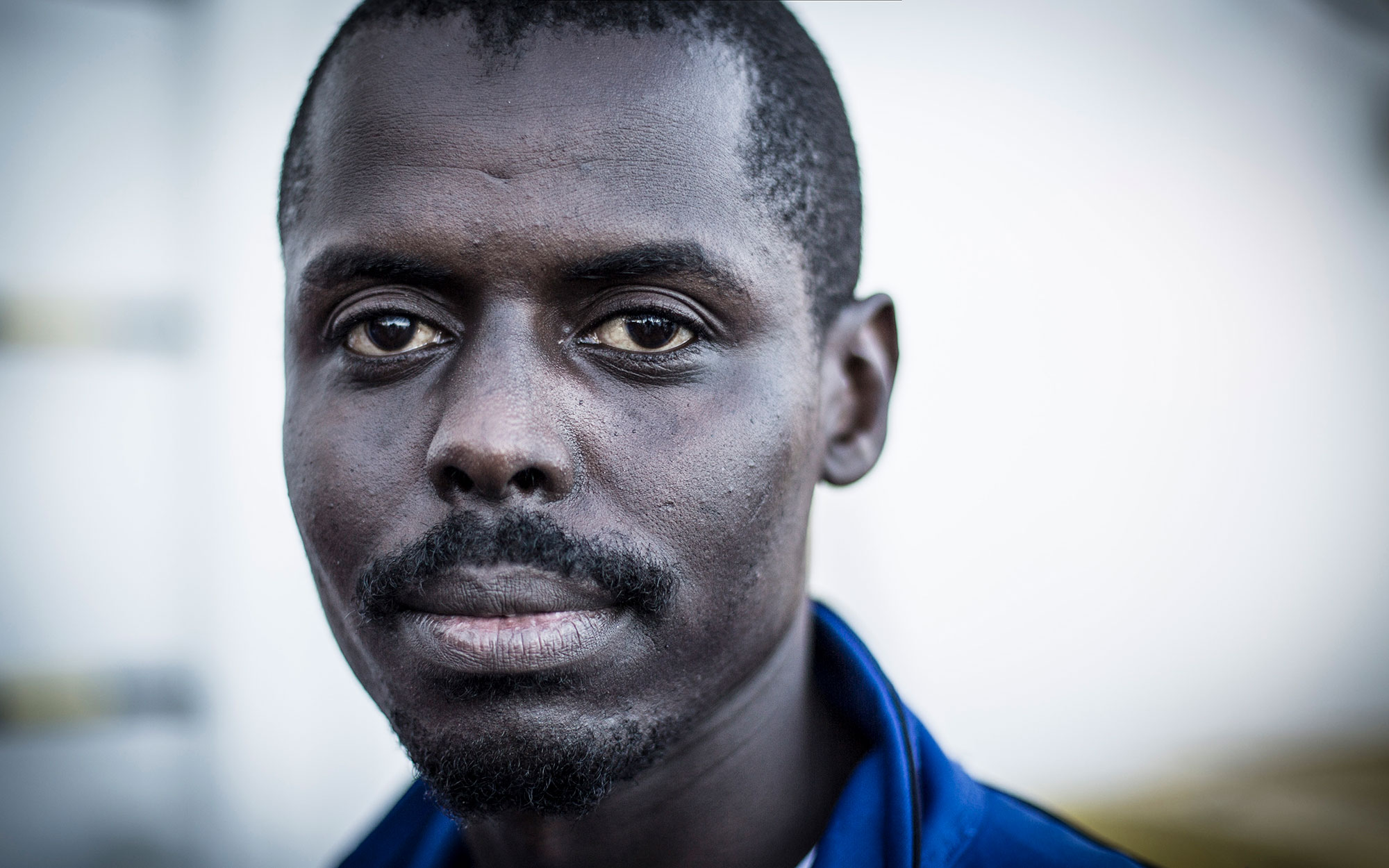 Photograph of Adam, a 24-year-old from Darfur.