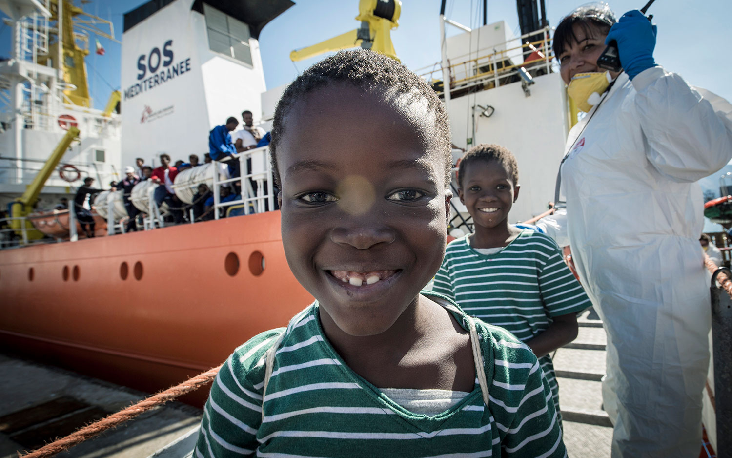 Lorum ipsum dolor; Children smile as they disembark the Aquarius in Palermo. October 13, 2017.