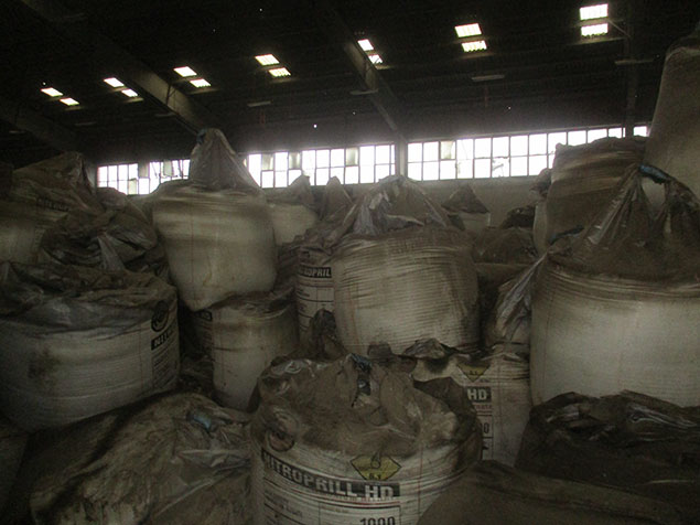 Piled bags inside the warehouse
